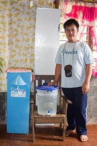 Von Auristela with his family's water filter.