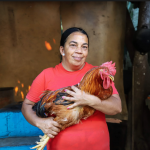 Woman from Dominican Republic holding chicken